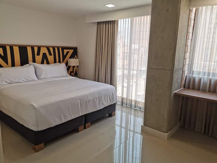 Suite con AC cama King size en Origen Local Suites