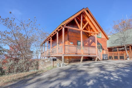 Cozy log cabin w/ a private hot tub, mountain views, & lots of room