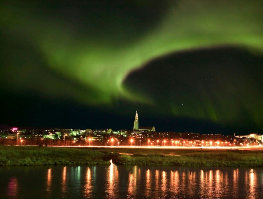 Aurora ( Northern lights ) over Reykjavik Capital