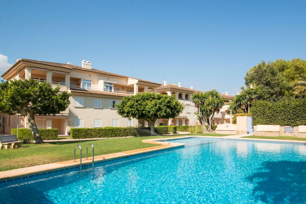 Relax in the communal gardens and pool.