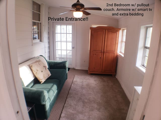 Private Entrance 2nd Bedroom w/ pull out couch.  Armoire w/ Cable TV, Air Mattress, extra pillows/bedding