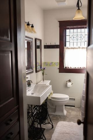 Full bath with shower and tub. Shared.