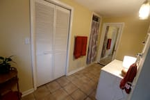 The bathroom is large and features a large walk in shower.