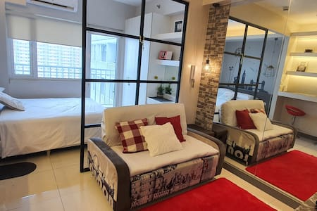Minimalist Condostay facing Manila Bay for 4 guest