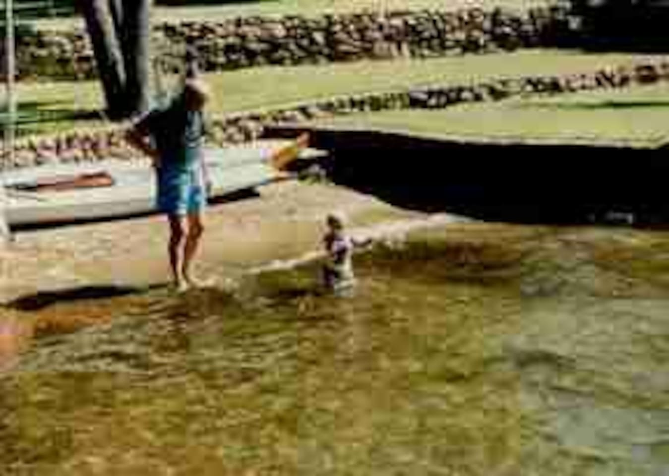 1981 Grandpa letting grandson play on beach.