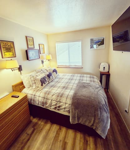 2nd out of 3 bedrooms with a queen bed, Eddie Bauer cabin theme bedding