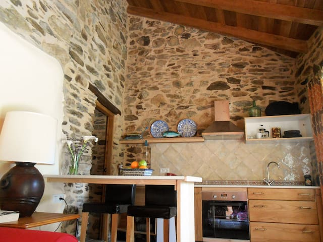 Guest suite in a rustic stone house