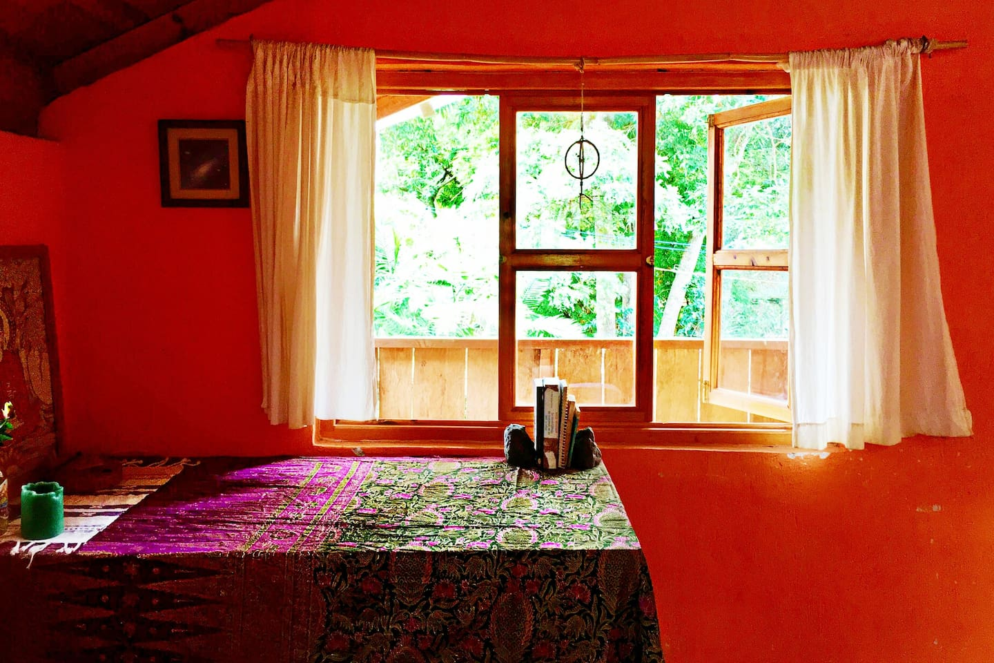 Peaceful sacred space with a magical view of the jungle and volcanoes.