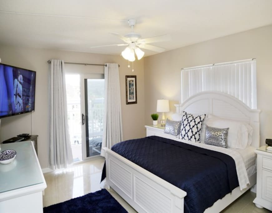 Peaceful master bedroom with King memory foam mattress, flatscreen TV and walkout out to your private balcony