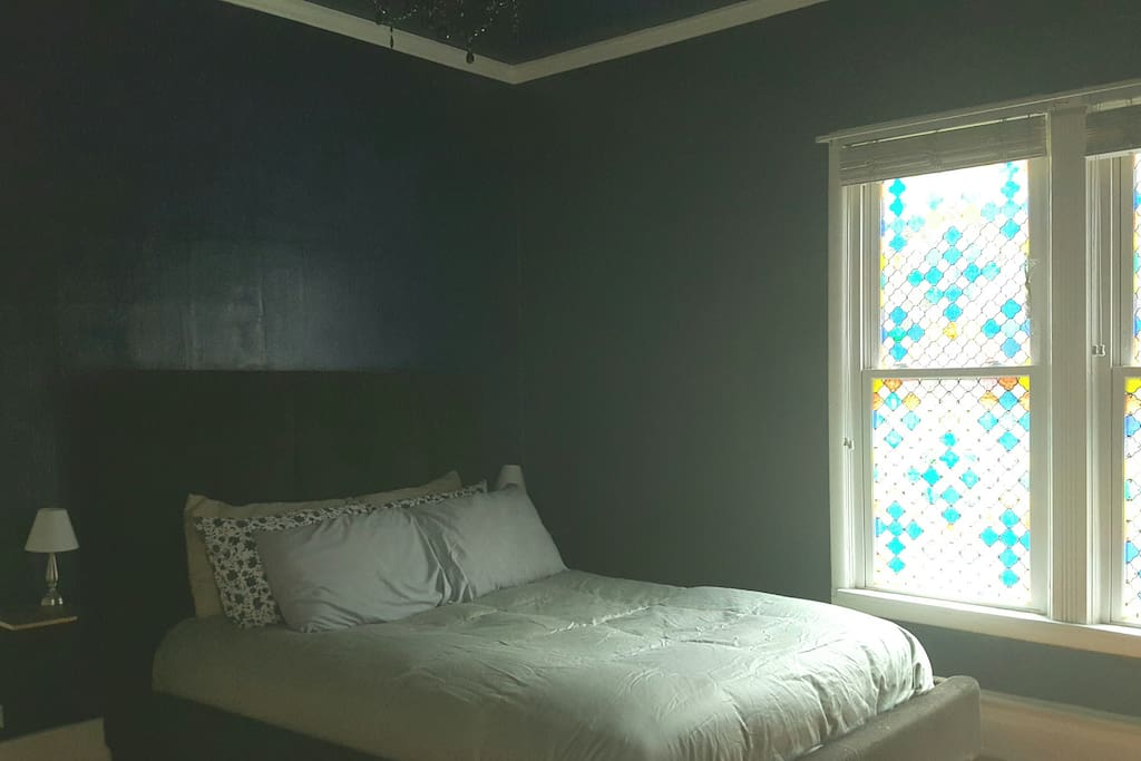 Bedroom with south-facing privacy window