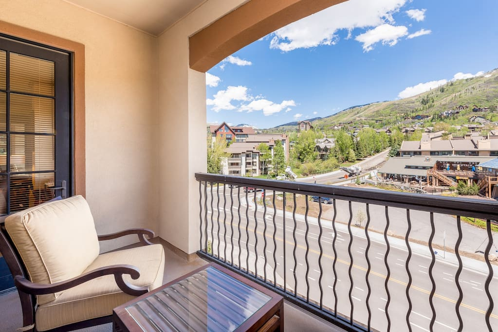 A private balcony offers views of the mountains and seating for 2.