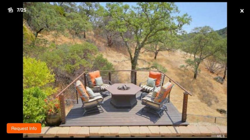 Relax in the sitting area with fire pit overlooking bocci court and valley to Rockville park... Great place for morning coffee, meditation, evening glass of wine and appetizers