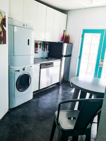 Small but functional  kitchen that has everything you would need to include a pub style table, dishwasher, fridge, stove top, washer/dryer, coffee maker microwave and toaster