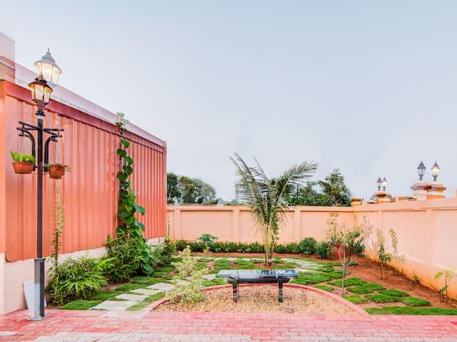 OYO - 1BR Residence in Pattanur w/ a Backyard