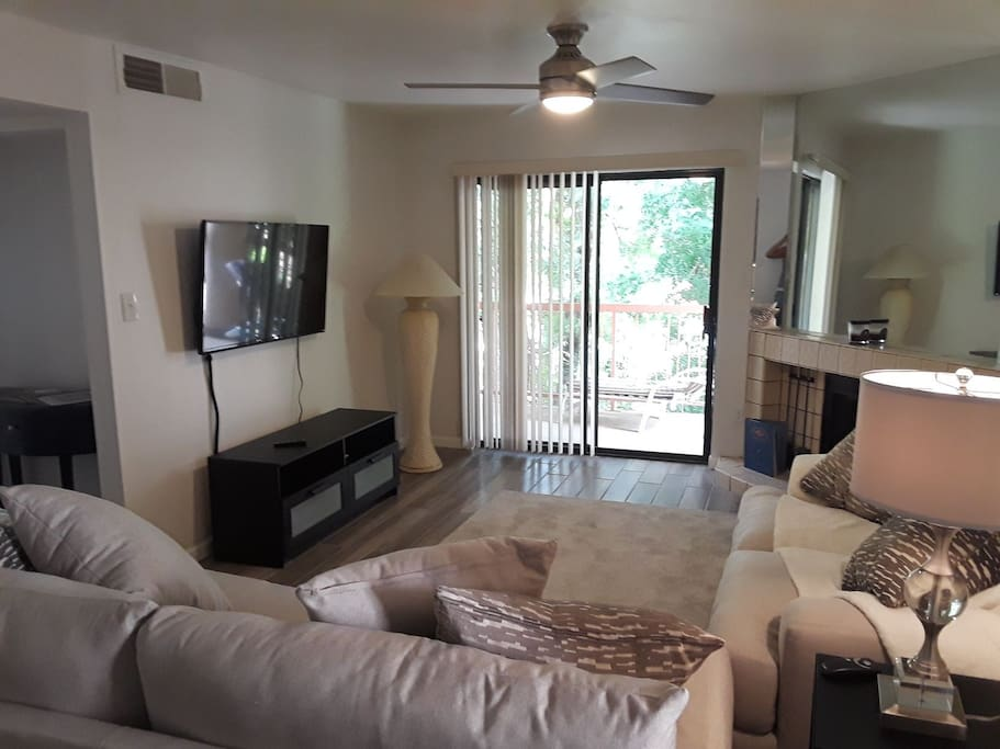 brand new LED TV. Cox internet. Brand new entertainment center, comfy couches and balcony overlooking pool and hot tub area