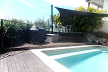 Pool and Under Cover Entertainment area with BBQ and Sun Deck.