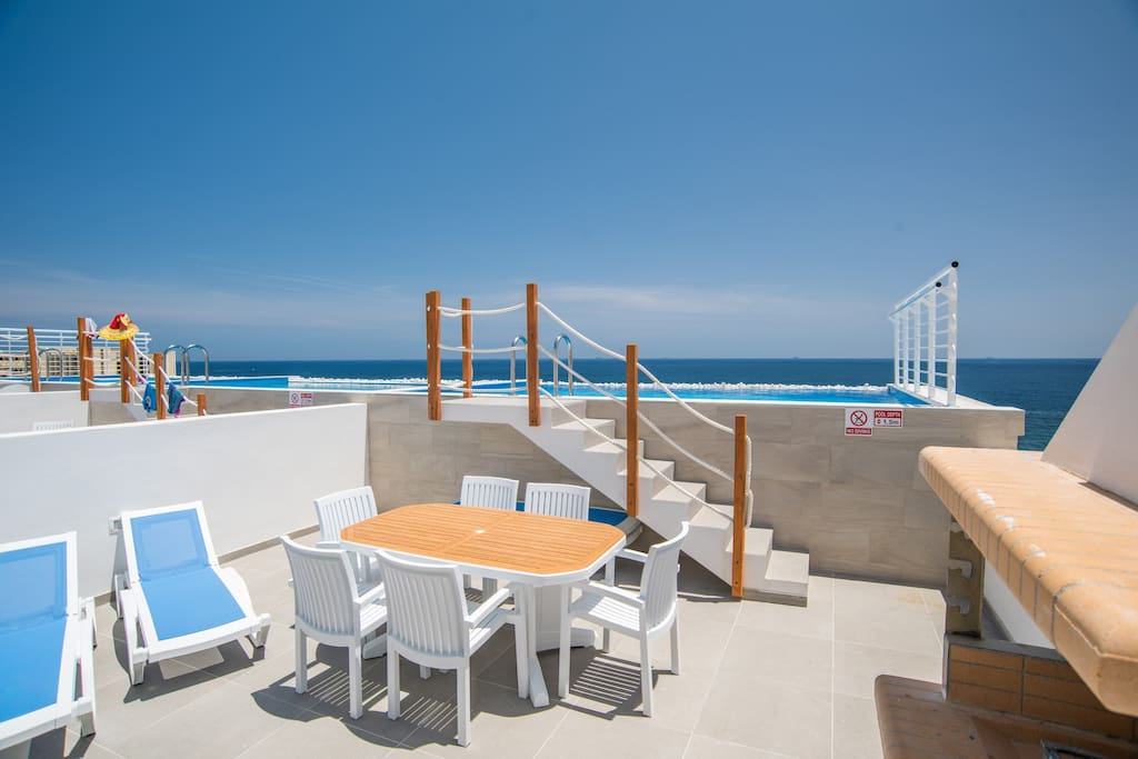 Outdoor Area; Table, Chairs and Sun Loungers