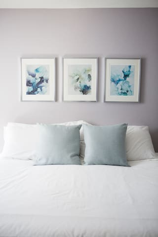 King-sized bed and beautiful framed paintings (all artwork is for sale)
