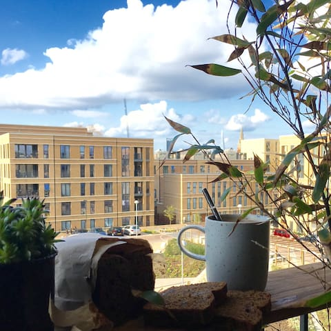 Enjoy a cup of coffee & the view over the city of London.