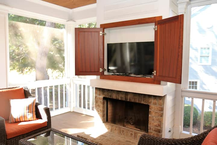 Enjoy our outdoor Tv and screened porch at Marina Cottage