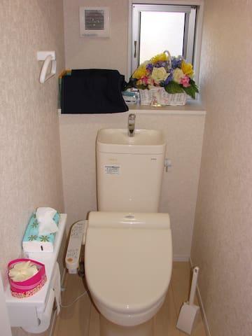 The restroom has Washlet (bidet).