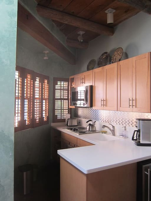 Kitchenette with microwave oven and small refrigerator and freezer