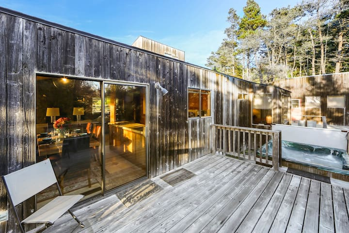 Unique home w/ a furnished deck, hot tub, fenced yard & ocean view