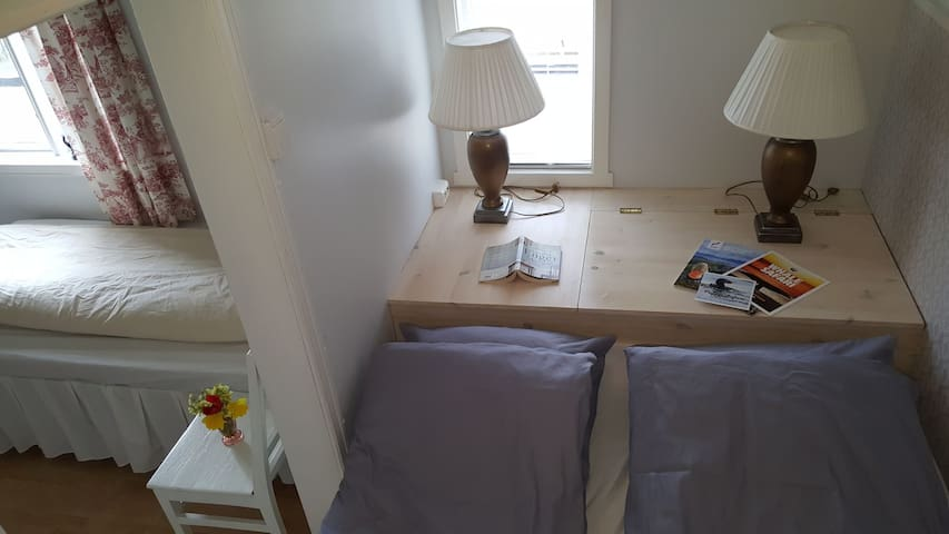 Our double room with an extra bed/sofa.