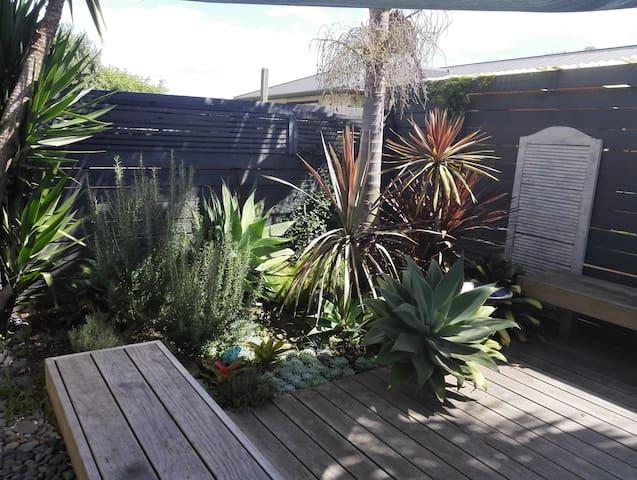 Stylish unit, sunny private patio.
