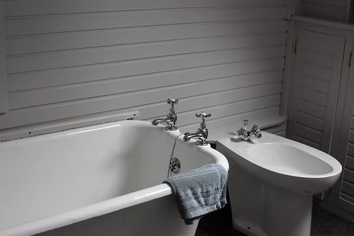 Upstairs bathroom with bath