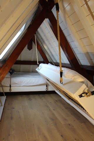 Loft with two hanging beds