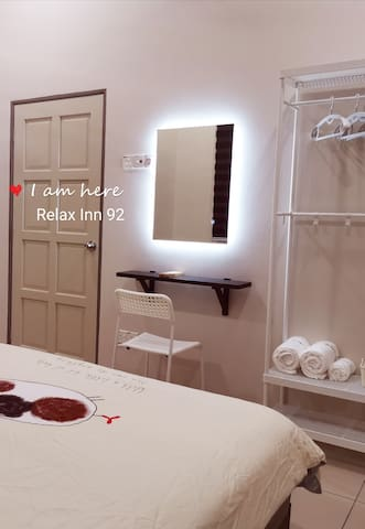 Bedroom with touch screen lighting mirror on wall