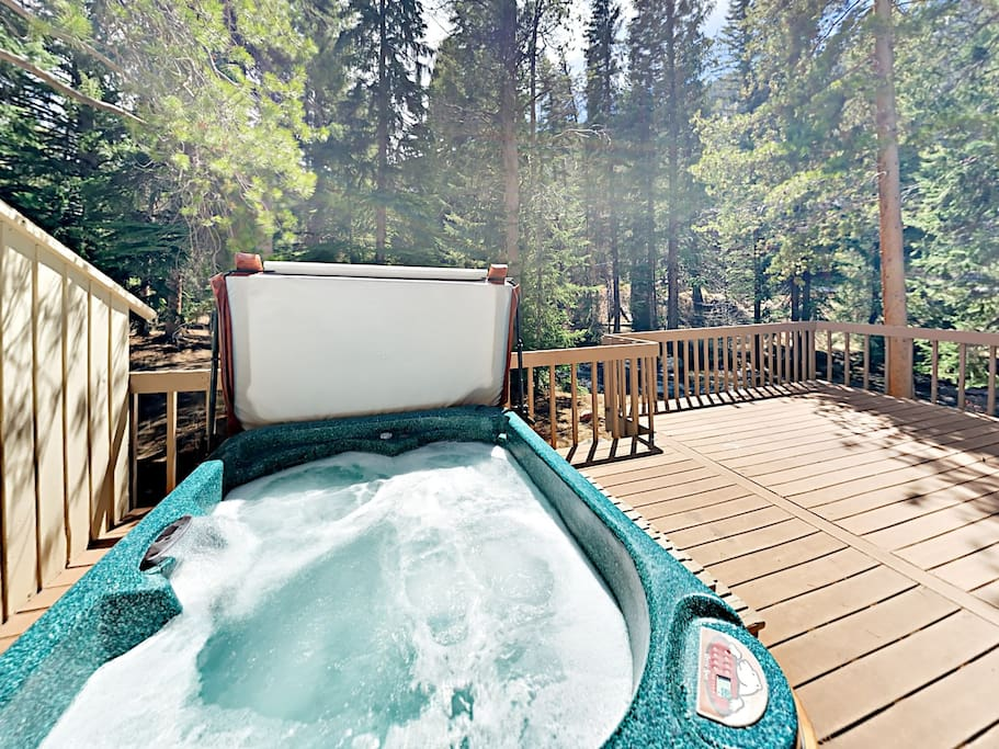 Soak in the private hot tub on the spacious deck.
