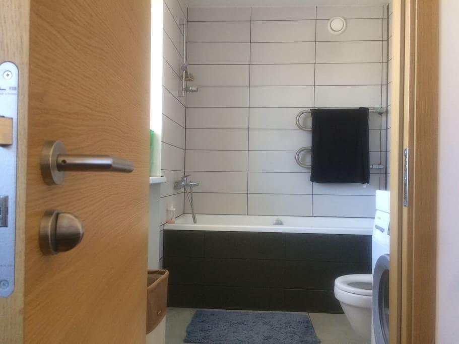 Bathroom features a large bathtub.