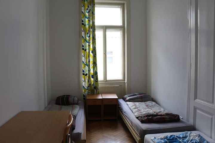 This room is very bright during the day, but you can also close the curtains and block all the light.