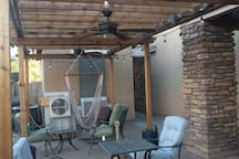 pergola side yard sitting area with misters