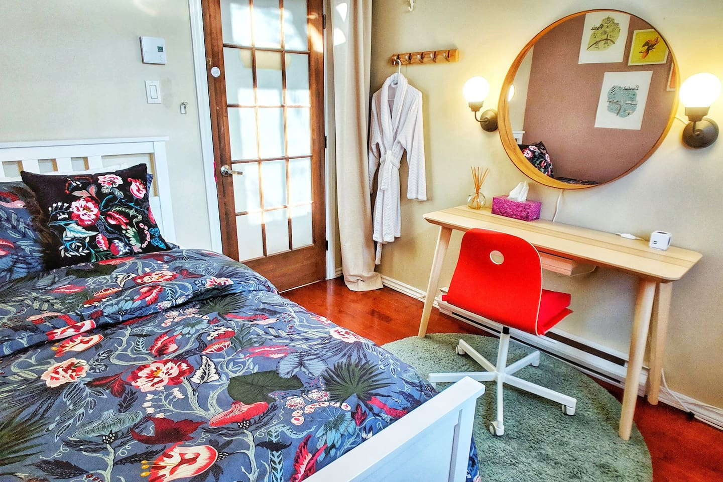 Your wonderfully cozy and traveler thoughtful private room, complete with laptop desk, vanity mirror, USB charging ports, and personal climate control!