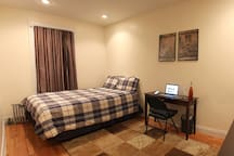 Queen bed, sleeps 2 comfortably. Desk and chair for working (laptop not included :)