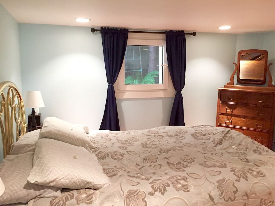 The bedroom.  Queen sized bed.  The comforter cover is washed after every stay (but of course!).