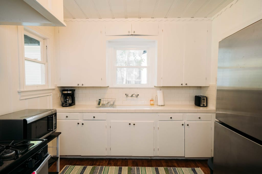 This is the kitchen. It comes with a microwave, full refrigerator, gas stove, toaster, blender and coffee maker. Note, there is no dishwasher.