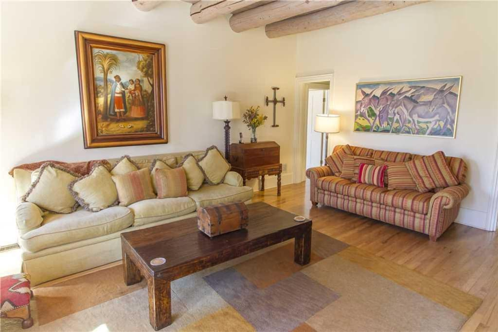 Luxury and Comfort - Plush leather seating paired with rich decor causes the family room to embody both luxury design and cozy re
