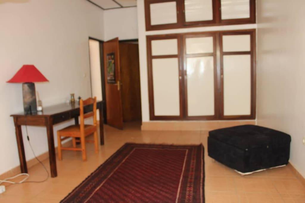 desk, wardrobe and bathroom access