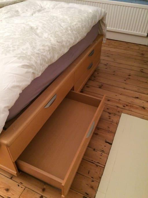 Storage drawer in bed