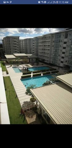 Fully furnished w/ Balcony fronting pool amenities