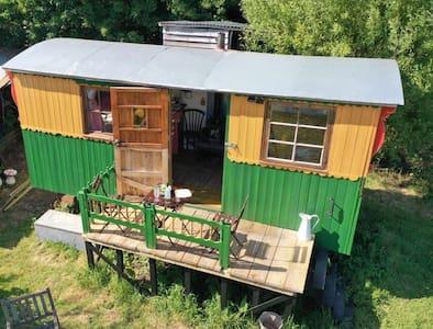 Beautiful bohemian shepherds hut located in meadow
