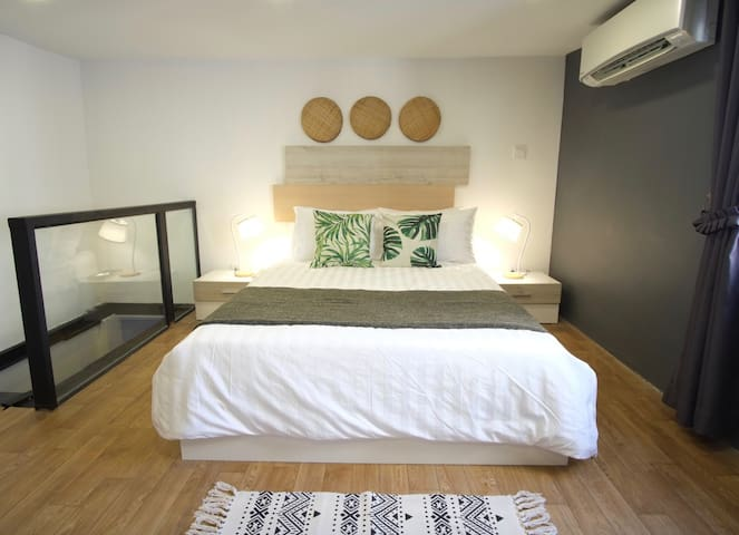 The chic nature toned furnishings within the spacious room conveys a sense of serenity and restfulness during your stay.