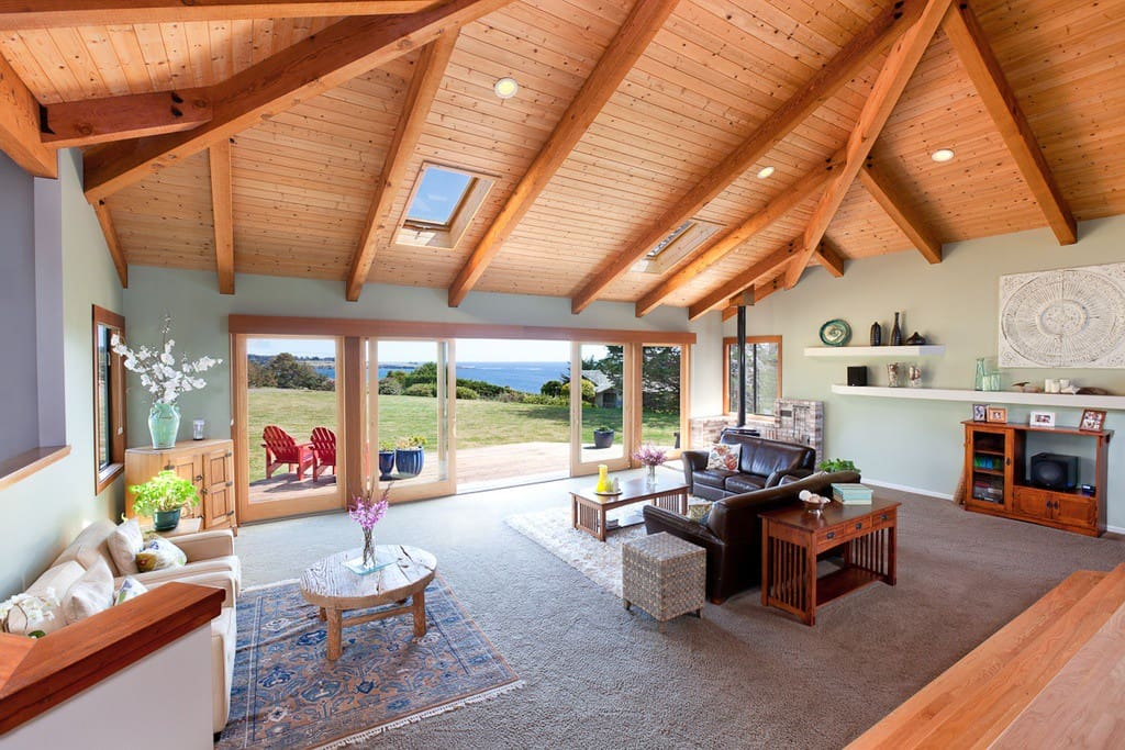 Overlooking the Pacific, the Living Room opens to the Deck and Hot Tub