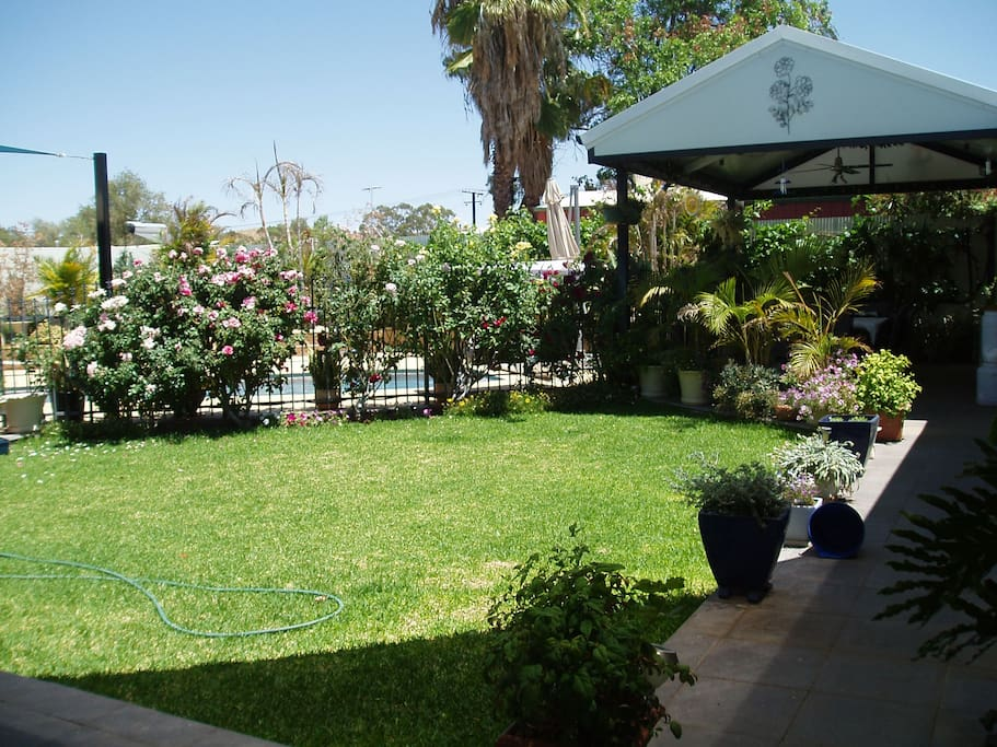 Back garden with pool/spa & BBQ area
