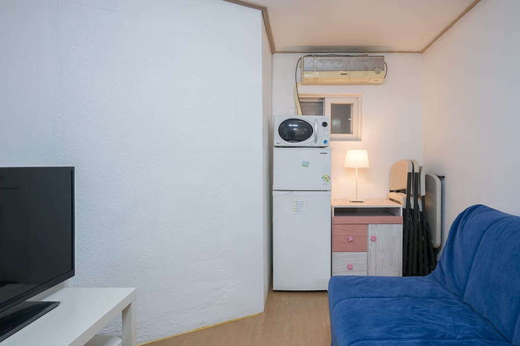 "Room 2 (can use as living room, 1 double sofa bed, 42""TV, regrigerator, microwave. hanger, air conditioner)"
