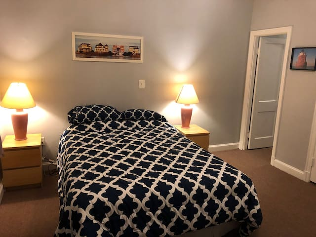 Large FirstBedroom with queen bed.